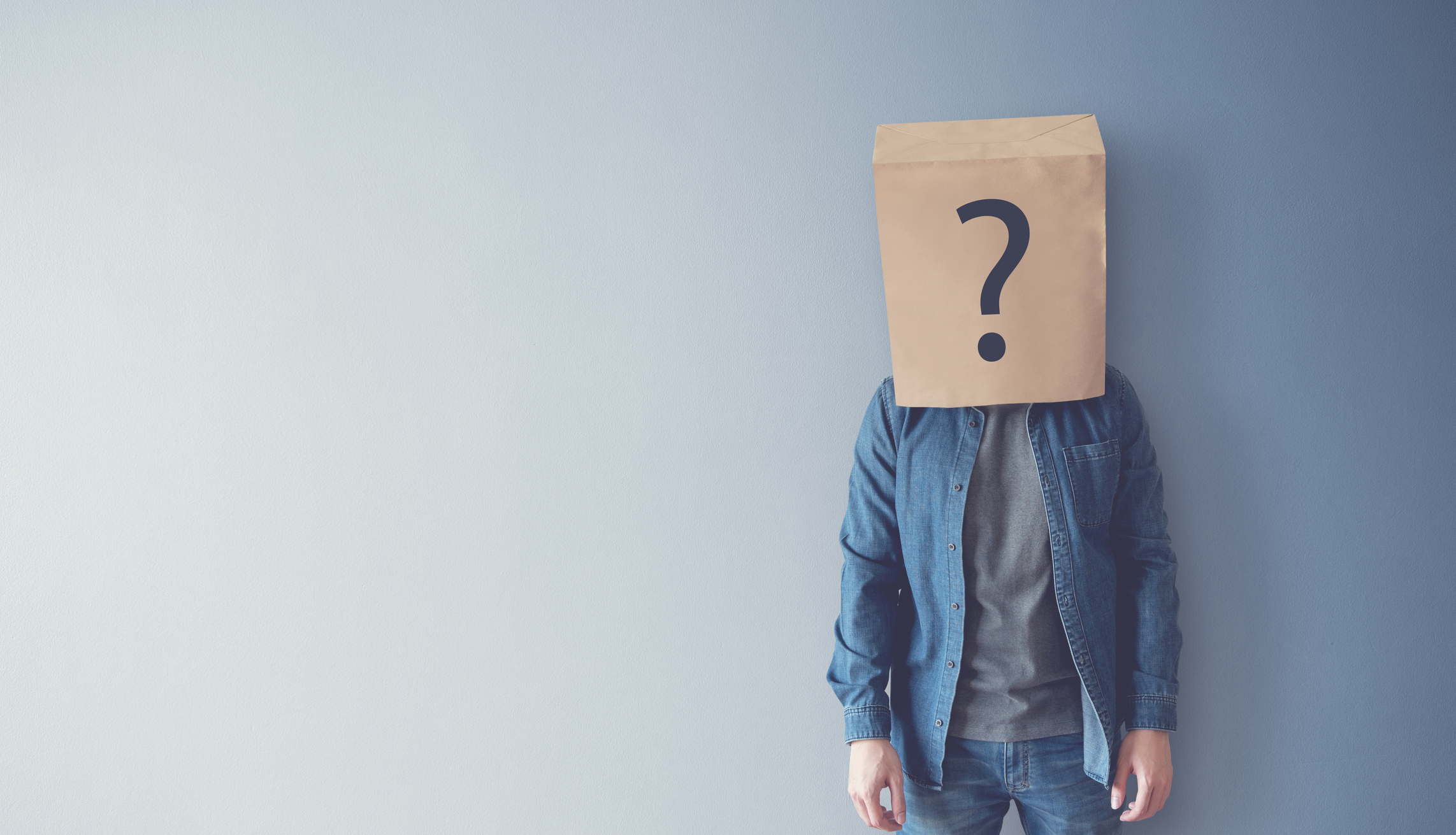Man has Confused, Thinking, Question Mark Icon on Paper Bag, copy space.